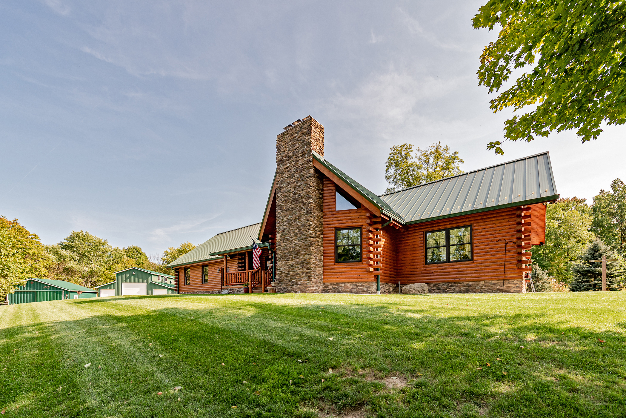 Charming, Amish-built, cabin-style log home with barn and stable for sale in Alliance